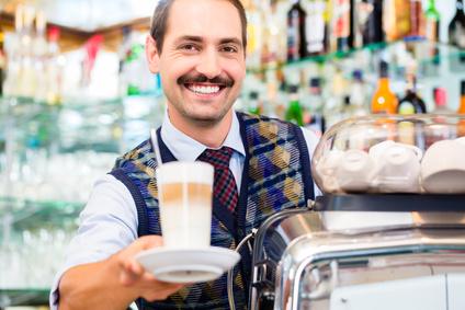 Barista in coffee bar